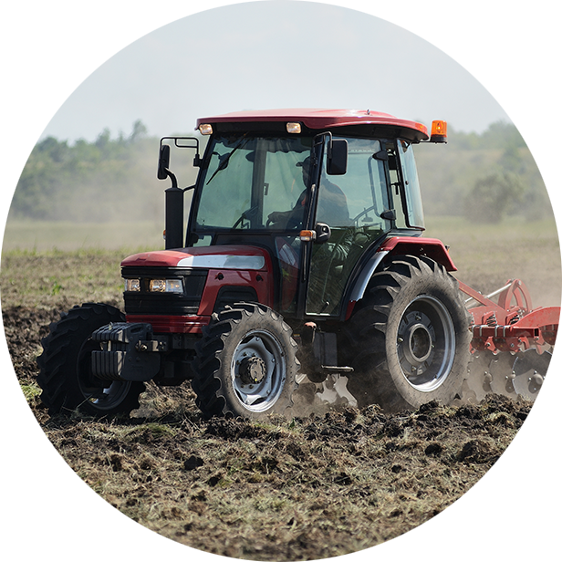 Agricultural Tractor plowing in a field